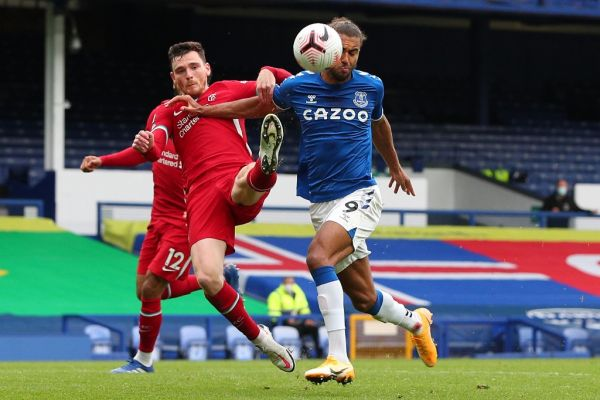 Everton's English striker Dominic Calvert-Lewin (R) vies with Liverpool's Scottish defender Andrew Robertson during the English Premier League football match between Everton and Liverpool at Goodison Park in Liverpool, north west England on October 17, 2020. PHOTO | AFP