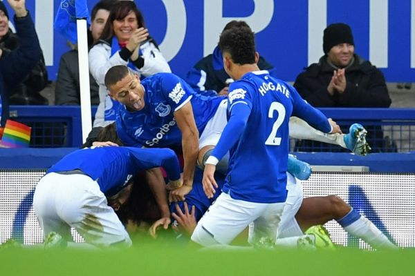 Everton's English striker Dominic Calvert-Lewin celebrates with teammates after scoring their second goal during the English Premier League football match between Everton and Chelsea at Goodison Park in Liverpool, north west England on December 7, 2019. PHOTO   AFP