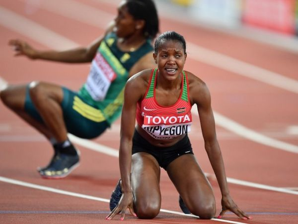 """Faith Chepngetich Kipyegon of Kenya reacts as she wins gold in the women's 1500 metres final during the """"IAAF Athletics World Championships London 2017"""" at London Stadium in the Queen Elizabeth Olympic Park in London, United Kingdom on August 7, 2017. PHOTO/AFP"""