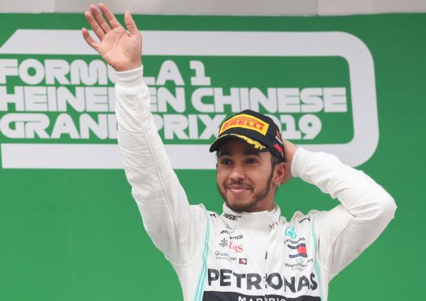 File photo taken on April 14, 2019 shows Mercedes driver Lewis Hamilton of Britain celebrating on the podium after winning the Chinese Formula One Grand Prix at the Shanghai International Circuit in Shanghai, east China. Mercedes driver Lewis Hamilton was crowned Formula 1 world champion for the sixth time this season with 413 points. The 34-year-old Briton is now just one title shy of Michael Schumacher's record of seven. PHOTO | AFP