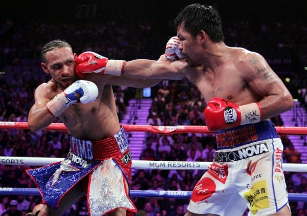 Filipino boxer Manny Pacquiao (R) connects with a right to the face of US boxer Keith Thurman during their WBA super world welterweight title fight at the MGM Grand Garden Arena on July 20, 2019 in Las Vegas, Nevada. Pacquiao won a 12 round split decision. PHOTO | AFP