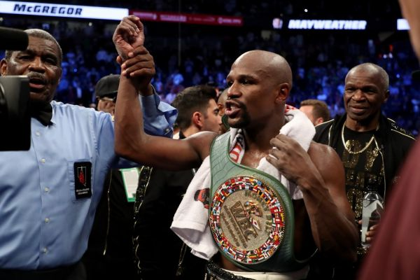 Floyd Mayweather Jr. celebrates with the WBC Money Belt after his TKO of Conor McGregor in their super welterweight boxing match on August 26, 2017 at T-Mobile Arena in Las Vegas, Nevada. PHOTO | AFP