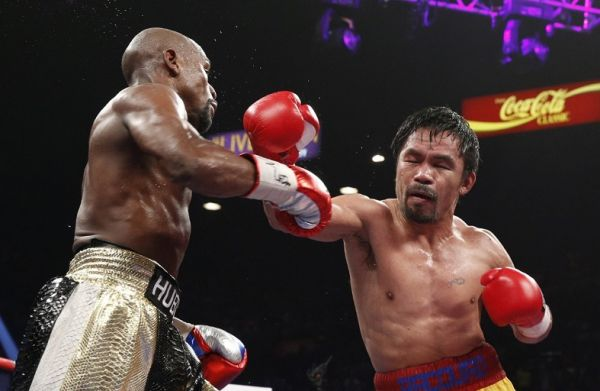 Floyd Mayweather Jr. exchange punches with Manny Pacquiao during their welterweight unification championship bout, May 2, 2015 at MGM Grand Garden Arena in Las Vegas, Nevada. Mayweather defeated Pacquiao by unanimous decision. PHOTO | AFP