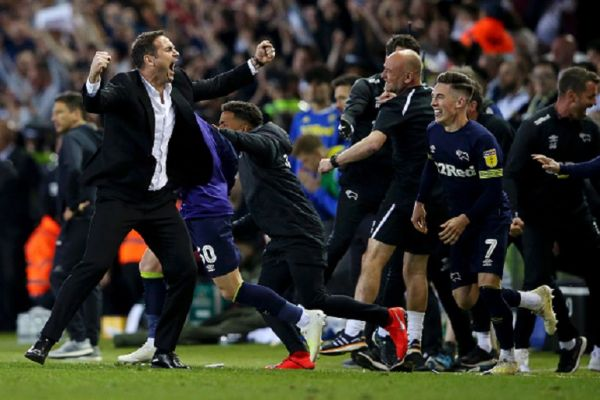 Frank Lampard, Manager of Derby County (L) celebrates victory following the Sky Bet Championship Play-off semi final second leg match between Leeds United and Derby County at Elland Road on May 15, 2019 in Leeds, England. PHOTO/ GETTY IMAGES