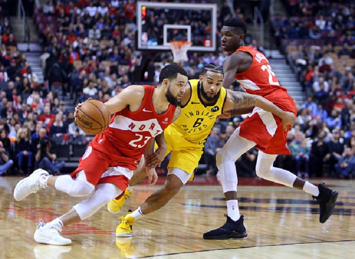 Fred VanVleet #23 of the Toronto Raptors dribbles the ball as Cory Joseph #6 of the Indiana Pacers defends during the second half of an NBA game at Scotiabank Arena on January 6, 2019 in Toronto, Canada. PHOTO/GettyImages