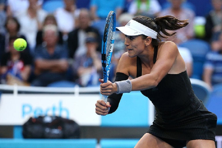 Garbine Muguruza of Spain plays a backhand to Ash Barty of Australia during day five of the 2019 Hopman Cup at RAC Arena on January 02, 2019 in Perth, Australia. PHOTO/GettyImages