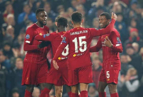 Georginio Wijnaldum of Liverpool FC celebrates with team mates after scoring the opening goal during the UEFA Champions League group E match between Liverpool FC and KRC Genk at Anfield on November 05, 2019 in Liverpool, United Kingdom.PHOTO/ GETTY IMAGES