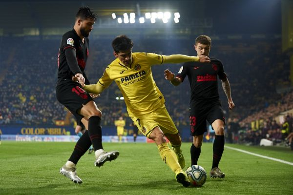 Gerard Moreno of Villarreal and Felipe Monteiro and Kieran Trippier of Atletico Madrid competes for the ball during the Liga match between Villarreal CF and Club Atletico de Madrid at Estadio de la Ceramica on December 6, 2019 in Villareal, Spain. PHOTO | AFP