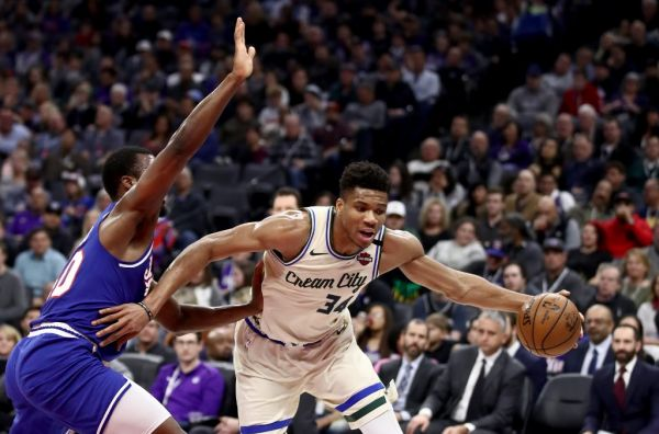 Giannis Antetokounmpo #34 of the Milwaukee Bucks drives on Harrison Barnes #40 of the Sacramento Kings at Golden 1 Center on January 10, 2020 in Sacramento, California. PHOTO | AFP