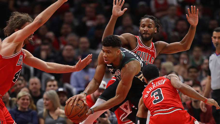 Giannis Antetokounmpo #34 of the Milwaukee Bucks tries to move surrounded by (L-R) Robin Lopez #42, Shaquille Harrison #3 and Wayne Selden #14 of the Chicago Bulls at the United Center on February 11, 2019 in Chicago, Illinois. PHOTO/AFP