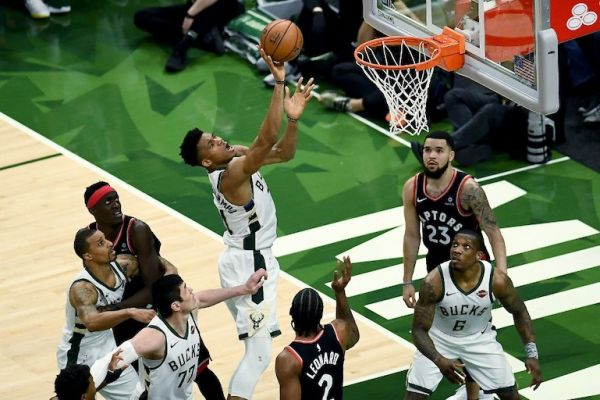 Giannis Antetokounmpo (left) of the Milwaukee Bucks attempts a shot in the fourth quarter against the Toronto Raptors during Game Two of the Eastern Conference Finals of the 2019 NBA Playoffs at the Fiserv Forum on May 17, 2019 in Milwaukee, Wisconsin. PHOTO/AFP