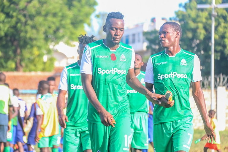 Gor Mahia FC captain Harun Shakava and Nicholas Kipkirui walk off the pitch after their 2-1 SPL defeat to Bandari FC at the Mbaraki Sports Complex on Saturday, December 8, 2018. PHOTO/SPN
