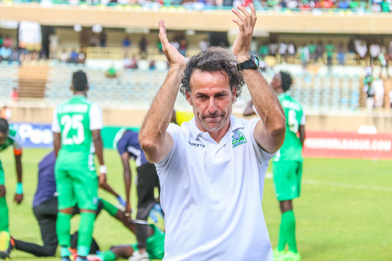 Gor Mahia FC head coach, Hassan Oktay, applauds following their Mashemeji Derby victory over AFC Leopards at the MIS, Kasarani earlier this month. PHOTO/SPN