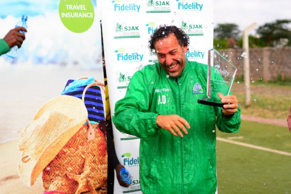 Gor Mahia FC head coach, Hassan Oktay, is splashed with water when receiving his plaque as the Fidelity Coach of the Month for April winner at Camp Toyoyo Grounds, Nairobi on May 23, 2019. PHOTO/Courtesy