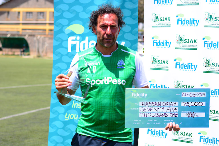Gor Mahia FC head coach, Hassan Oktay poses with his trophy and KSh75,000 cheque when he was named the Fidelity Insurance/SJAK Coach of the Month for February on March 21, 2019. PHOTO/Courtesy