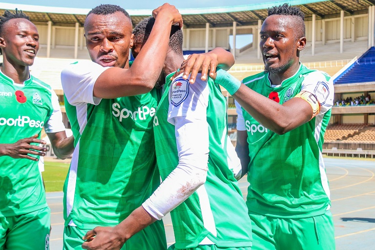 Gor Mahia FC players (L to R) Shafiq Batambuze, Jacques Tuyisenge and Harun Shakava celebrate the opening goal with scorer Kenneth Muguna (partly hidden) during their SportPesa Premier League Mashemeji Derby against AFC Leopards SC at the Moi International Sports Centre, Kasarani on Saturday, February 9, 2019. PHOTO/SPN