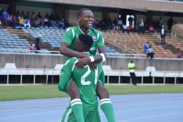 Gor Mahia FC striker Nicholas Kipkurui is hoisted by teammate Kenneth Muguna (number 21) after scoring during their 3-1 victory over AFC Leopards SC during their SportPesa Premier League Mashemeji Derby clash at the MISC Kasarani Stadium in Nairobi on Sunday, May 19, 2019. PHOTO/Brian Kinyanjui/SPN