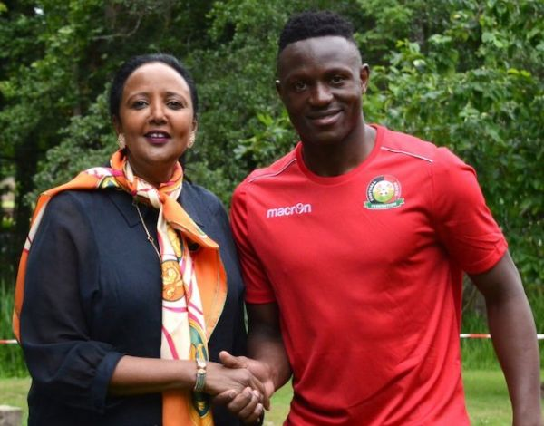 Harambee Stars captain, Victor Wanyama (right) poses with Cabinet Secretary for Sports, Culture and Heritage when the minister visited their training camp in France on Sunday, June 9, 2019. PHOTO/Courtesy/Victor Wanyama