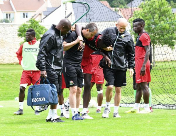 Harambee Stars defender, Brian Mandela (3rd left) is assisted out of the training pitch after injuring his knee on Monday, June 10, 2018. PHOTO/Courtesy/FKF