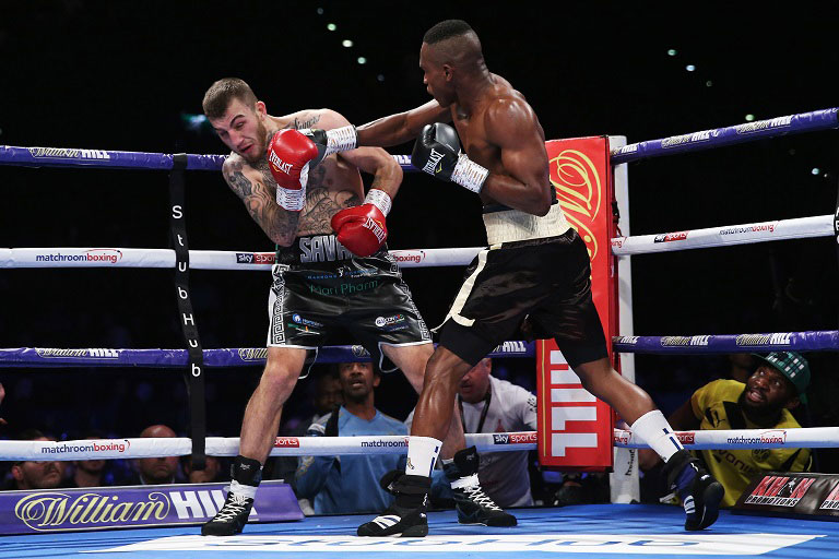 Hassan Mwakinyo (R) of Tanzania battles with Sam Eggington of England during their Super-Welterweight bout held at Arena Birmingham on September 8, 2018 in Birmingham, England. PHOTO/Getty Images