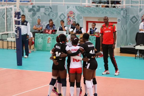 Head coach Paul Bitok (in red) watches as Malkia Strikers celebrate their victory agaisnt Nigeria in Morocco on August 28, 2019. PHOTO/ NOCK