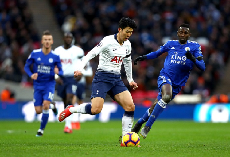 Heung-Min Son of Tottenham Hotspur and Wilfred Ndidi of Leicester City in action during the Premier League match between Tottenham Hotspur and Leicester City at Wembley Stadium on February 10, 2019 in London, United Kingdom. PHOTO/GettyImages