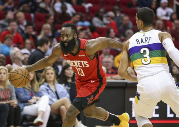 Houston Rockets guard James Harden (13) drives with the ball as New Orleans Pelicans guard Josh Hart (3) defends during the second quarter at Toyota Center. PHOTO | PA Images