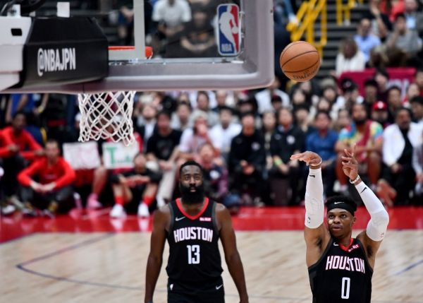 Houston Rockets guard Russell Westbrook (R) shoots a free throw as teammate James Harden looks on during the National Basketball Association (NBA) Japan Games 2019 pre-season basketball match between the Houston Rockets and Toronto Raptors in Saitama, a northern suburb of Tokyo on October 10, 2019. PHOTO | AFP