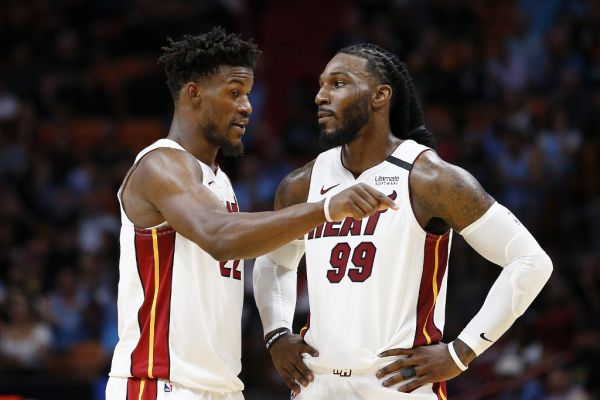 immy Butler #22 of the Miami Heat talks with Jae Crowder #99 against the Minnesota Timberwolves during the second half at American Airlines Arena on February 26, 2020 in Miami, Florida. PHOTO | AFP