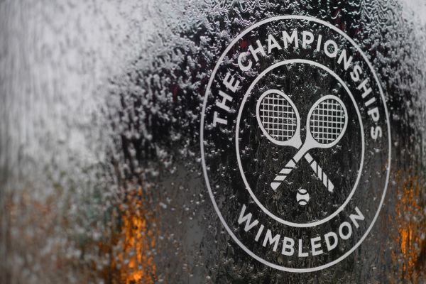 In this file photo a water feature with the Wimbledon logo stands by the members area at the All England Tennis Club in Wimbledon, southwest London, on July 1, 2018, on the eve of the 2018 Wimbledon Championships tennis tournament. Roger Federer and Serena Williams were among the tennis stars left devastated on Wednesday as Wimbledon was cancelled for the first time since World War II due to the coronavirus. The cancellation of the oldest Grand Slam tournament at London's All England Club leaves the season in disarray, with no tennis set to be played until mid-July. PHOTO | AFP