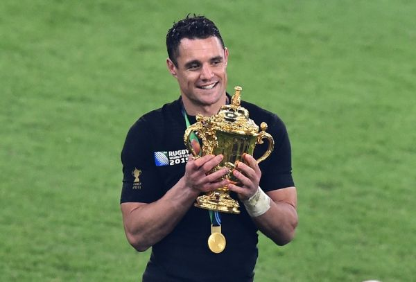 In this file photo New Zealand's fly half Dan Carter holds the Webb Ellis Cup as he celebrates winning the final match of the 2015 Rugby World Cup between New Zealand and Australia at Twickenham stadium, south west London, on October 31, 2015. All Blacks legend Dan Carter announced his return to Super Rugby at the age of 38 on Thursday, extending the career of the double Rugby World Cup winner and three times world player of the year. PHOTO | AFP