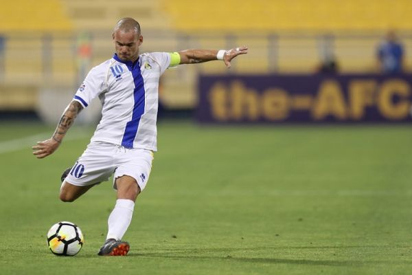 In this file photo taken on April 03, 2018 Al Gharafa's Dutch forward Wesley Sneijder drives the ball during the AFC Champions League match between Qatar's al-Gharafa and UAE's Al-Jaziraat at the Thani Bin Jassim Stadium in Doha. Former Dutch iconic midfielder Wesley Sneijder said on August 12, 2019 that he had definitively finished his professional career at the age of 35. PHOTO | AFP