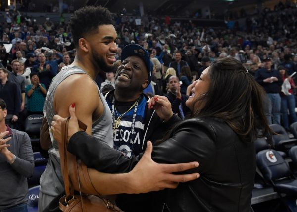 In this file photo taken on April 10, 2018 Karl-Anthony Towns #32 of the Minnesota Timberwolves hugs his parents, Karl and Jackie Towns after winning the game against the Denver Nuggets at the Target Center in Minneapolis, Minnesota. The Timberwolves defeated the Nuggets 112-106. Jacqueline Towns, mother of Minnesota Timberwolves center Karl-Anthony Towns, died April 13, 2020 of complications of the coronavirus, the NBA team announced. PHOTO | AFP