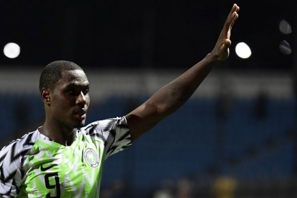 In this file photo taken on July 06, 2019 Nigeria's forward Odion Ighalo greets the fans during the 2019 Africa Cup of Nations (CAN) Round of 16 football match between Nigeria and Cameroon at the Alexandria Stadium in the Egyptian city. Former English Premier League forward Odion Ighalo could be the Nigerian who bursts the South African bubble when the countries clash on July 10 in an Africa Cup of Nations quarter-final. PHOTO | AFP