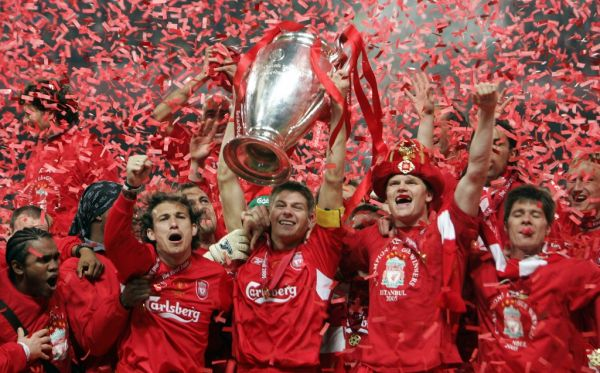 In this file photo taken on May 25, 2005, Liverpool's captain Steven Gerrard holds the throphy surrounded by teammates at the end of the UEFA Champions league football final AC Milan vs Liverpool, at the Ataturk Stadium in Istanbul. Liverpool won 3-2 on penalties. PHOTO   AFP