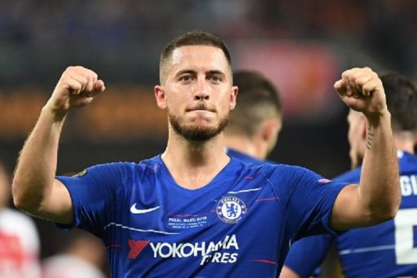 In this file photo taken on May 30, 2019 Chelsea's Belgian midfielder Eden Hazard celebrates after celebrates after scoring a goal during the UEFA Europa League final football match between Chelsea FC and Arsenal FC at the Baku Olympic Stadium in Baku, Azerbaijian. Belgian forward Eden Hazard joins Real Madrid from Chelsea the club announced on June 7, 2019.PHOTO/ AFP