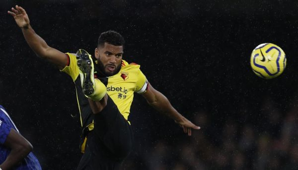"""In this file photo taken on November 02, 2019 Watford's English-born Jamaican defender Adrian Mariappa (R) controls the ball during the English Premier League football match between Watford and Chelsea at Vicarage Road Stadium in Watford, north of London. Watford defender Adrian Mariappa said news that he had tested positive on May 20, 2020, for the coronavirus COVID-19, came as a """"big surprise"""" as he has felt no ill effects. The 33-year-old was one of three positive tests at Watford with the other two among staff members. PHOTO 