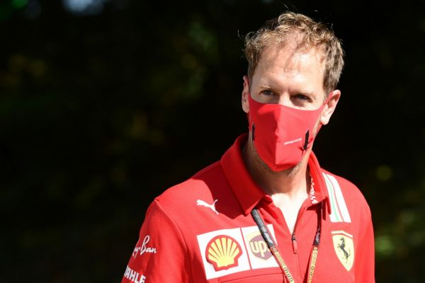 "In this file photo taken on September 03, 2020 Ferrari's German driver Sebastian Vettel wears a protective face mask as he visits the track with team members at the Autodromo Nazionale circuit in Monza ahead of the Italian Formula One Grand Prix. Sebastian Vettel has signed for the renamed Aston Martin team for the 2021 season ""and beyond"", the ambitious British Formula One outfit announced on September 10, 2020. The 33-year-old German won four consecutive titles from 2010 to 2013 with Red Bull before joining Ferrari, but the Italian team has not renewed his contract. PHOTO 