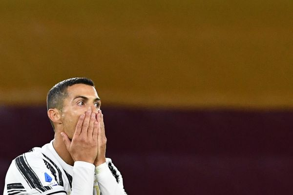 In this file photo taken on September 27, 2020 Juventus' Portuguese forward Cristiano Ronaldo reacts after missing a goal opportunity during the Italian Serie A football match Roma vs Juventus on September 27, 2020 at the Olympic stadium in Rome. Cristiano Ronaldo has tested positive for Covid-19, the Portuguese Football Federation announced on October 13, 2020. PHOTO | AFP