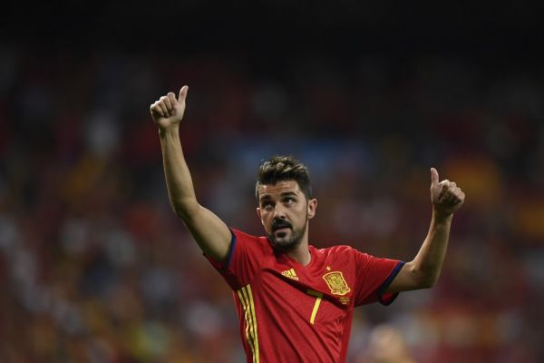 In this file photo taken on September 2, 2017 Spain's forward David Villa waves as he celebrates their victory at the end of the World Cup 2018 qualifier football match Spain vs Italy at the Santiago Bernabeu stadium in Madrid. Star striker Villa, who holds the record for most international goals scored for Spain, announced on November 13, 2019 he was quitting professional football at the end of the season. PHOTO | AFP