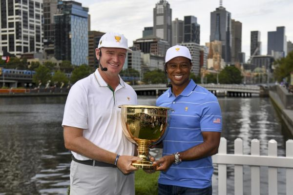 International team captain Ernie Els of South Africa (L) and Tiger Woods, captain of the US team (R) hold the Presidents Cup trophy in Melbourne on December 9, 2019. The Presidents Cup is to be played at the Royal Melbourne Colf Club from December 12-15. PHOTO | AFP