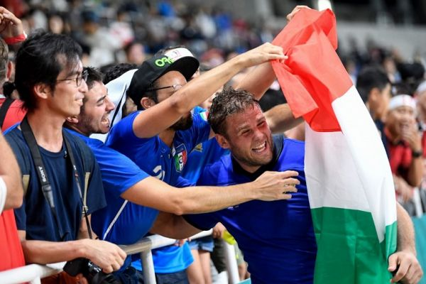 Italy's lock Dean Budd (R) celebrates with supporters after victory during the Japan 2019 Rugby World Cup Pool B match between Italy and Canada at the Fukuoka Hakatanomori Stadium in Fukuoka on September 26, 2019. PHOTO | AFP