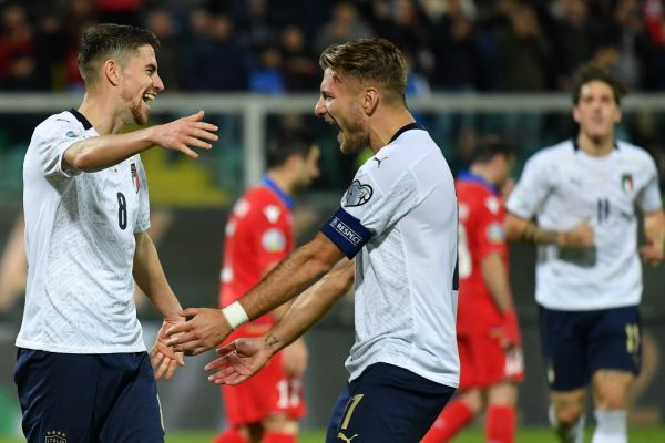 Italy's midfielder Jorginho (L) celebrates with Italy's forward Ciro Immobile after scoring during the Euro 2020 1st round Group J qualifying football match Italy v Armenia on November 18, 2019 at the Renzo-Barbera stadium in Palermo. PHOTO | AFP