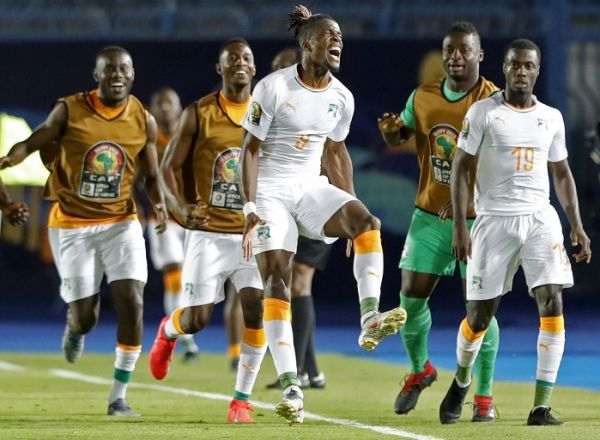 Ivory Coast's forward Wilfried Zaha (3rd-R) celebrates after scoring a goal during the 2019 Africa Cup of Nations (CAN) Round of 16 football match between Ivory Coast and Mali at the Suez Stadium in the north-eastern Egyptian city on July 8, 2019. PHOTO | AFP