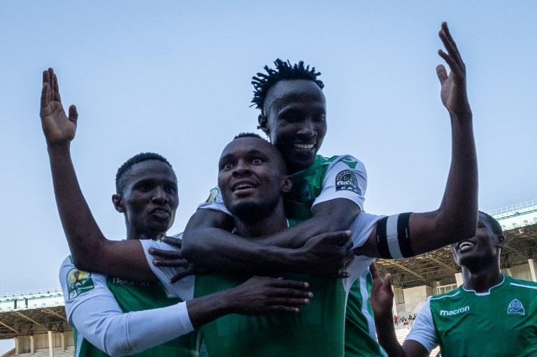 Jacques Tuyisenge of Kenya's Gor Mahia (C, below) celebrates with Batambuze Shafik (C, above) after scoring his second goal during their CAF Confederations Cup football match against Egypt's Zamalek at The Kasarani Stadium in Nairobi on February 3, 2019. Kenya's Gor Mahia won by 4-2 against Egypt's Zamalek. PHOTO/AFP