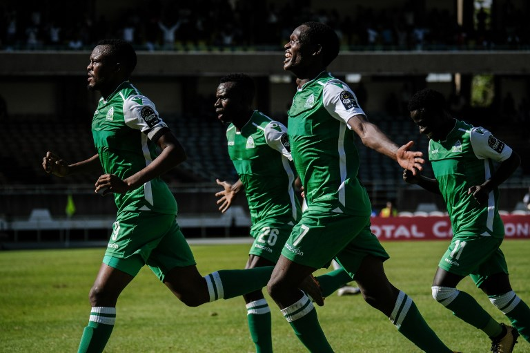 Jacques Tuyisenge of Kenya's Gor Mahia (C, below) celebrates with Batambuze Shafik (C, above) after scoring his second goal during their CAF Confereration cup football match against Egypt's Zamalek at The Kasarani Stadium in Nairobi on February 3, 2019. Kenya's Gor Mahia won by 4-2 against Egypt's Zamalek. PHOTO/AFP
