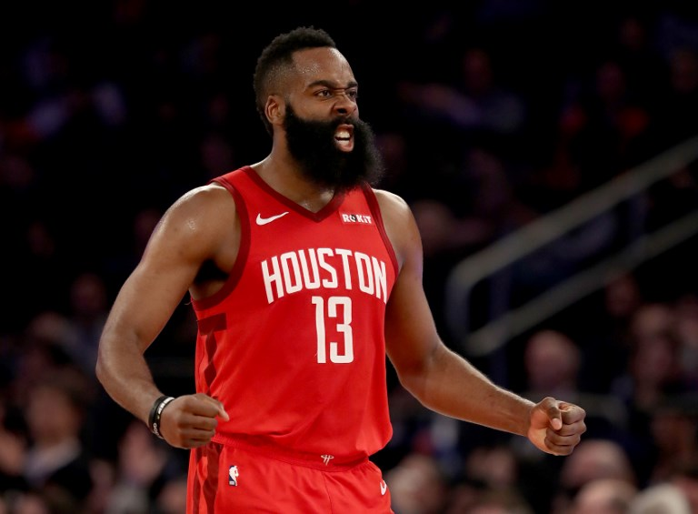 James Harden #13 of the Houston Rockets celebrates after teammate Gerald Green dunked in the third quarter against the New York Knicks at Madison Square Garden on January 23, 2019 in New York City. PHOTO/AFP