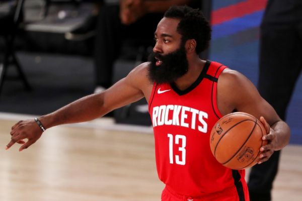 James Harden #13 of the Houston Rockets dribbles during the second half against the Dallas Mavericks at The Arena at ESPN Wide World Of Sports Complex on July 31, 2020 in Lake Buena Vista, Florida. PHOTO | AFP