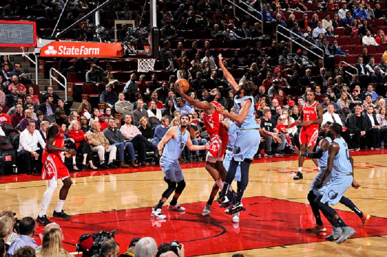James Harden #13 of the Houston Rockets drives to the basket during the game against Joakim Noah #55 of the Memphis Grizzlies on January 14, 2019 at the Toyota Center in Houston, Texas. PHOTO/GettyImages