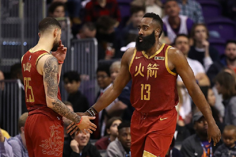 James Harden #13 of the Houston Rockets high fives Austin Rivers #25 after scoring against the Phoenix Suns during the second half of the NBA game at Talking Stick Resort Arena on February 04, 2019 in Phoenix, Arizona. PHOTO/GettyImages